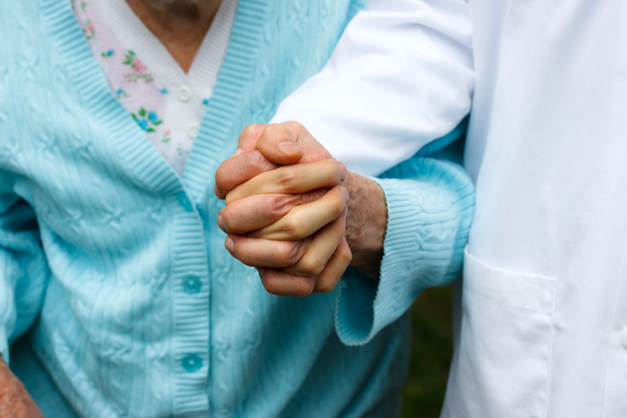 Senior Lady With Doctor, Holding Hands